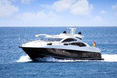 Private beautiful yacht sailing fast close to Alicante coast in Spain. Motor yacht sailing in the coast of Calpe in Alicante in a sunnt day in east coast of Stock Photo
