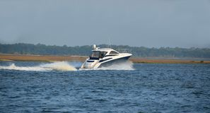 Motor yacht sailing on river Stock Image