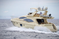 Motor yacht. Shot of a luxury motor yacht cruising the sea royalty free stock photography