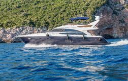Motor yacht under way out at Adriatic sea, Montenegro Stock Image