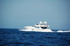 Motor yacht underway Stock Photo