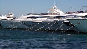 Motor yachts in the harbour stock video footage