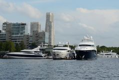 Motor yachts are moored in a parking lot at the Khimki Reservoir in Moscow. Royalty Free Stock Photos