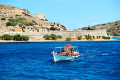 The motor yachts with tourists are near Spinalonga island Stock Photos