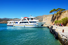 The motor yachts with tourists are near Spinalonga island Stock Photo