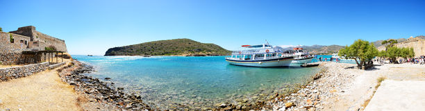 The motor yachts with tourists are near Spinalonga island Royalty Free Stock Photography