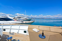 Motor-Yachts. View of a luxury yacht bow-deck and other motor-yachts at the background Stock Photos