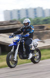 The motoracer on blurred background Stock Photo