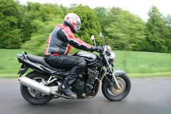 Motorbike. Fast motorbiker on the road with green background Stock Photo