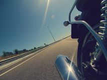 Motorbike backwards indoor camera with bright pipe on a highway Stock Photography