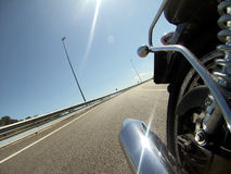 Motorbike backwards indoor camera with bright pipe on a highway Royalty Free Stock Photography