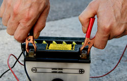 Motorbike battery with charging cable Royalty Free Stock Photos