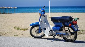 Motorbike on the beach. Blue motorbike view on the s Royalty Free Stock Photography