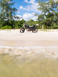 Motorbike at the beach. Next to sea Stock Photo