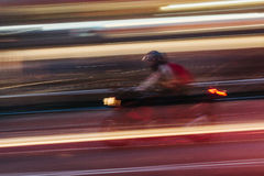 Motorbike in a Blurred City Scene Stock Images