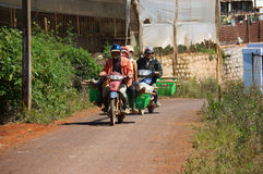 Motorbike carry farmers come home after working day Stock Photography