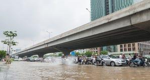 Motorbike Causing Splashes on the Road Stock Photography