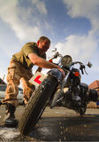 Motorbike Cleaning Stock Image