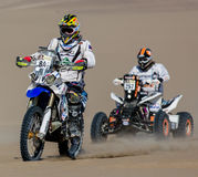 Motorbike contesters race- Dakar 2013 Royalty Free Stock Photography