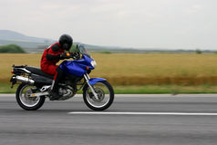 Motorbike drag. Blurry background. Panning work royalty free stock images