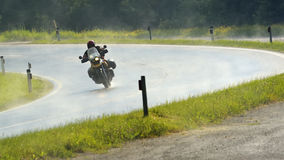 Motorbike driver in the rain no.2 Royalty Free Stock Images