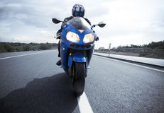 Motorbike driver on the road Royalty Free Stock Photo