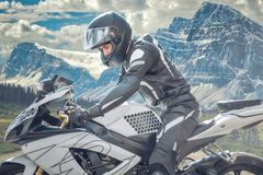 Motorbike driver in the snowy road, chilean mountains Stock Photography