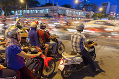 Motorbike drivers at the crossroad, Ho Chi Minh City Royalty Free Stock Photos