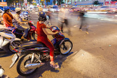 Motorbike drivers at the crossroad, Ho Chi Minh City Stock Images