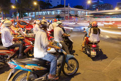 Motorbike drivers at the crossroad, Ho Chi Minh City Royalty Free Stock Image