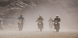 Motorbike driving in dust. Styria, Austria - June 7, 2015: Austria, EU - June 7th, 2015: Erzberg Rodeo 2015, Motocross Mekka for MX drivers around the world Royalty Free Stock Photo