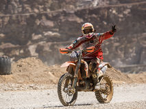Motorbike driving in dust. Styria, Austria - June 7, 2015: Austria, EU - June 7th, 2015: Erzberg Rodeo 2015, Motocross Mekka for MX drivers around the world Stock Photography