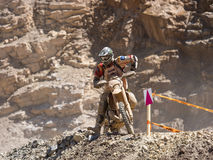 Motorbike driving in dust. Styria, Austria - June 7, 2015: Austria, EU - June 7th, 2015: Erzberg Rodeo 2015, Motocross Mekka for MX drivers around the world Royalty Free Stock Images