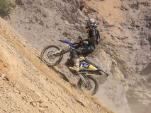 Motorbike driving in dust. Styria, Austria - June 7, 2015: Austria, EU - June 7th, 2015: Erzberg Rodeo 2015, Motocross Mekka for MX drivers around the world Royalty Free Stock Photography