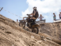 Motorbike driving uphill. Styria, Austria - June 7, 2015: Austria, EU - June 7th, 2015: Erzberg Rodeo 2015, Motocross Mekka for MX drivers around the world Royalty Free Stock Photos