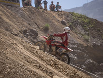 Motorbike driving uphill. Styria, Austria - June 7, 2015: Austria, EU - June 7th, 2015: Erzberg Rodeo 2015, Motocross Mekka for MX drivers around the world Stock Photography