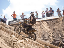 Motorbike driving uphill. Styria, Austria - June 7, 2015: Austria, EU - June 7th, 2015: Erzberg Rodeo 2015, Motocross Mekka for MX drivers around the world Royalty Free Stock Photo