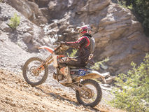 Motorbike driving uphill. Styria, Austria - June 7, 2015: Austria, EU - June 7th, 2015: Erzberg Rodeo 2015, Motocross Mekka for MX drivers around the world Stock Photo