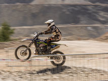 Motorbike driving uphill. Styria, Austria - June 7, 2015: Austria, EU - June 7th, 2015: Erzberg Rodeo 2015, Motocross Mekka for MX drivers around the world Stock Images