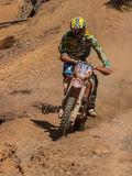 Motorbike driving uphill. Styria, Austria - June 7, 2015: Austria, EU - June 7th, 2015: Erzberg Rodeo 2015, Motocross Mekka for MX drivers around the world Royalty Free Stock Image