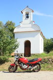 Motorbike in front of chapel Royalty Free Stock Photos
