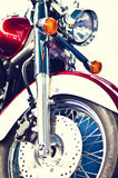 Motorbike front view of a wheel and disk brakes. Front view of a motorbike shiny wheel, disk brakes and head lights Royalty Free Stock Photography