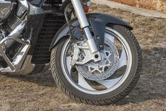 Motorbike front wheel with brake system closeup Royalty Free Stock Images