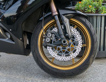 Motorbike front wheel with disc break Stock Images