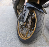 Motorbike front wheel with disc break and tire Royalty Free Stock Image