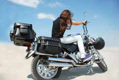 Motorbike and girl Stock Images