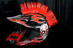 Motorbike helmet. And gloves on black background Stock Images