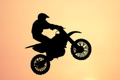 Motorbike jump. Motorcross motorbike jump silhouette extreme sports background Stock Photos