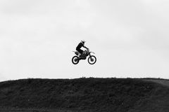 Motorbike jumping in the sky on hide speed Stock Photos