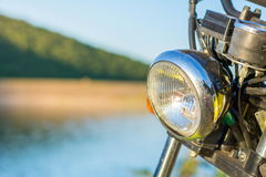 Motorbike by the lake close up. Summer exploration Royalty Free Stock Photos